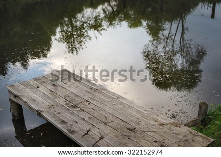 Close up of wooden jetty. Lake boat gangway - stock photo