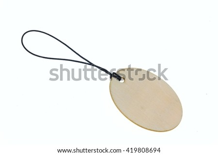 Close-up of wooden oval keychain with blank space.Isolated