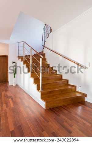 Close-up of wooden stairs in luxury house - stock photo