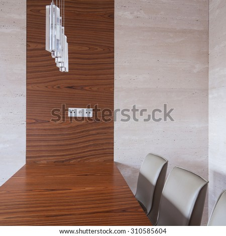 Close-up of wooden table in dining room