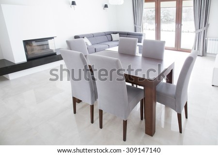 Close-up of wooden table in elegant interior - stock photo