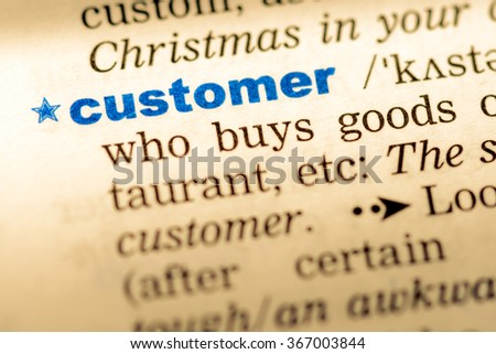 Close-up of word in English dictionary. Customer, definition and transcription