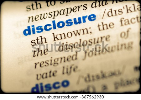 Close-up of word in English dictionary. Disclosure, definition and transcription - stock photo