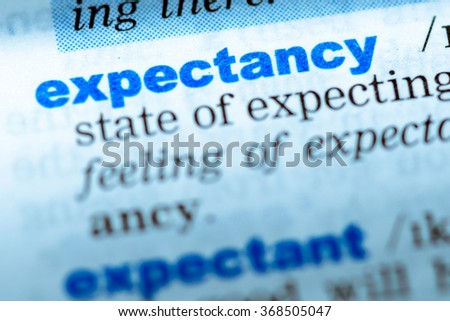 Close-up of word in English dictionary. Expectancy, definition and transcription