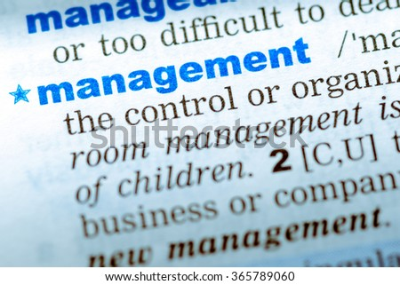 Close-up of word in English dictionary. Management, definition and transcription