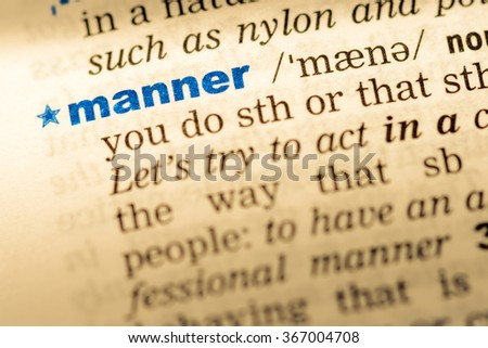 Close-up of word in English dictionary. Manner, definition and transcription