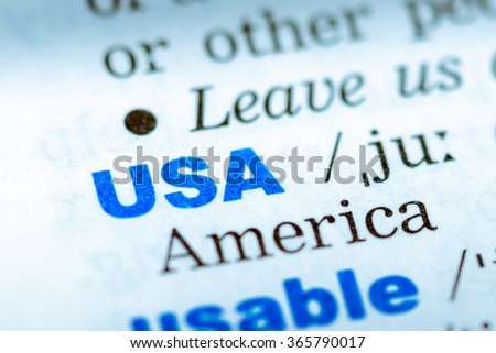 Close-up of word in English dictionary. USA, definition and transcription