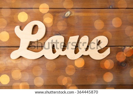 close up of word love cutout on wood