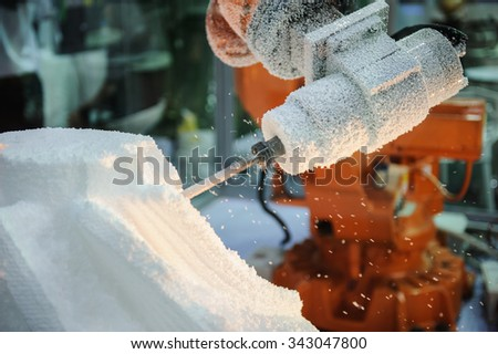 Close up of worker hands cut mesh on Styrofoam cutting machine - stock photo