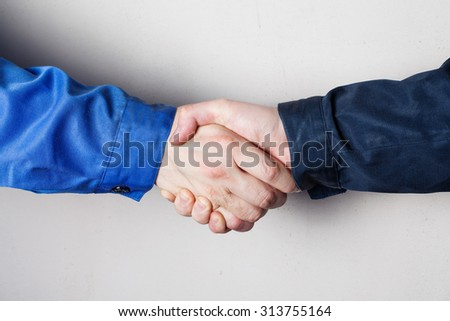 Close-up of workers handshake standing for a trusted partnership