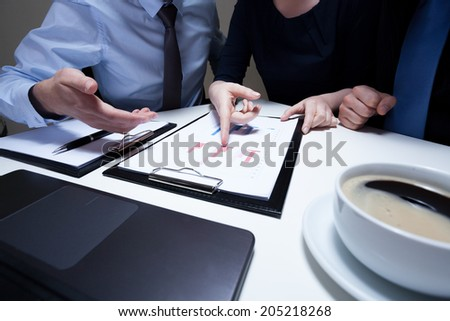 Close-up of workers on business meeting, horizontal