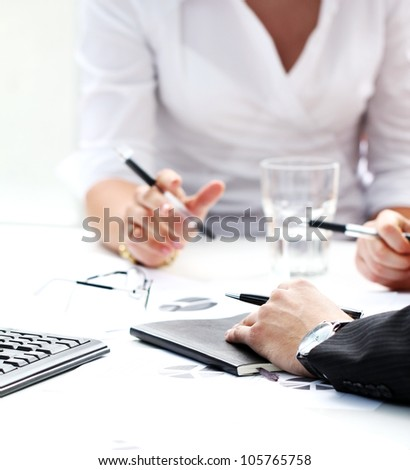 Close up of working process at business meeting - stock photo