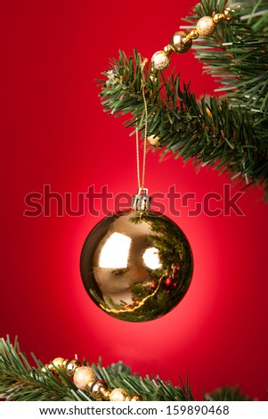 Close-up Of Yellow Decorative Bauble Hanged On Christmas Tree - stock photo