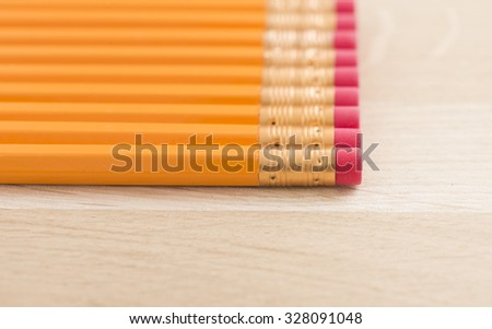 Close up of yellow pencils on wooden table. Concept of office work, writing and education.