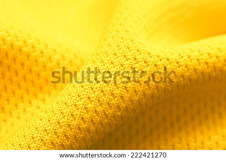 Close up of yellow polyester fabric - stock photo