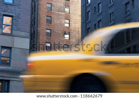 Close up of yellow taxi cab in blurred motion on Street in New York city
