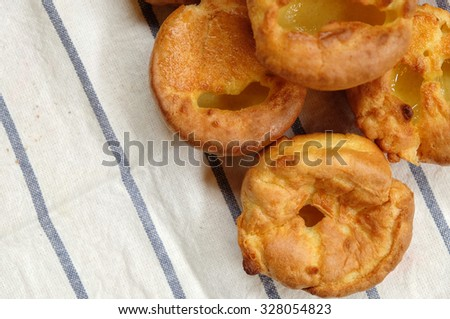 Close up of Yorkshire pudding on a White Fabric, From above, Selective Focus
