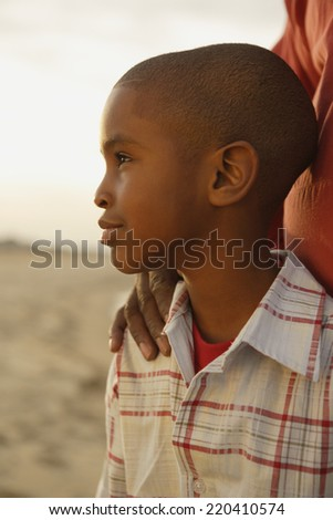 Close up of young African boy at beach - stock photo