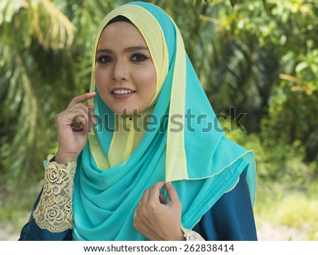 Close up of young beautiful Asian muslim woman wearing hijab.