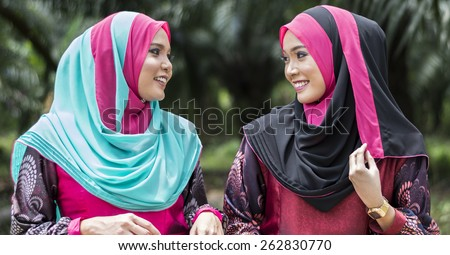 Close up of young beautiful Asian muslim womans wearing hijab. - stock photo