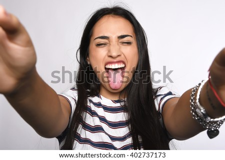 Close-up of young beautiful woman taking selfie. Isolated white background