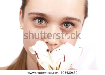 close up of young beautiful woman with a flower isolated on a white background - stock photo