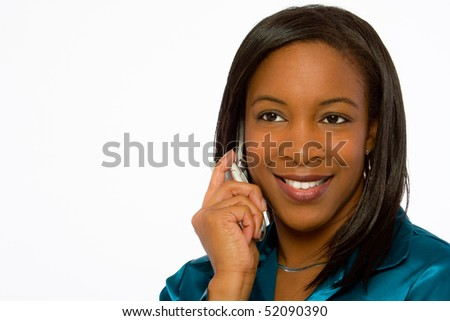 Close up of young black woman talking on mobile telephone. - stock photo