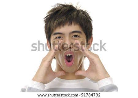 Close-up of young boy holding hands beside his cheeks and shouts an announcement