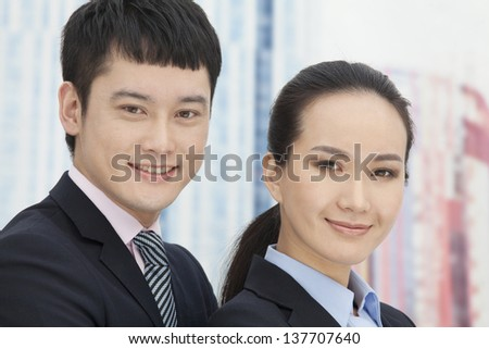 Close-up of young business man and woman, portrait