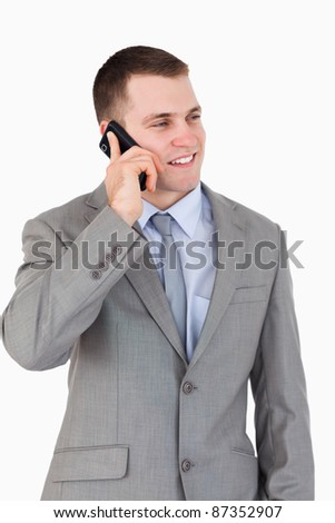Close up of young businessman on the phone on white background