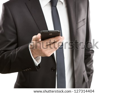 Close up of young businessman using smart phone isolated on white background - stock photo