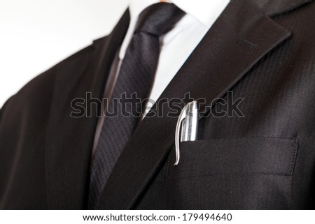 Close up of young businessman wearing black suit - stock photo