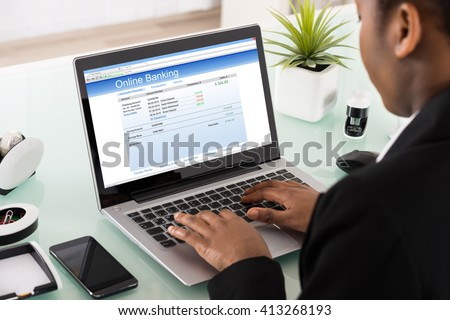 Close-up Of Young Businesswoman Using Online Banking Service On Laptop In Office