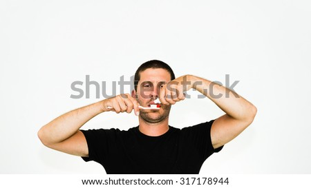 close-up of young caucasian man brushing his teeth -  isolated on white background with copyspace - stock photo