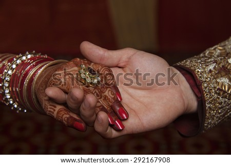 Close-up of young couple holding hands