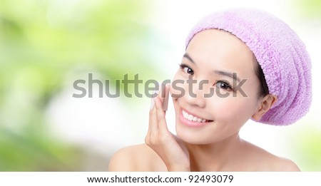Close up of Young Girl remove makeup by Cleansing Cotton with green background, Model is a asian Beauty - stock photo
