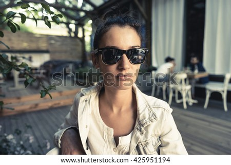 Close up of young girl with sunglasses