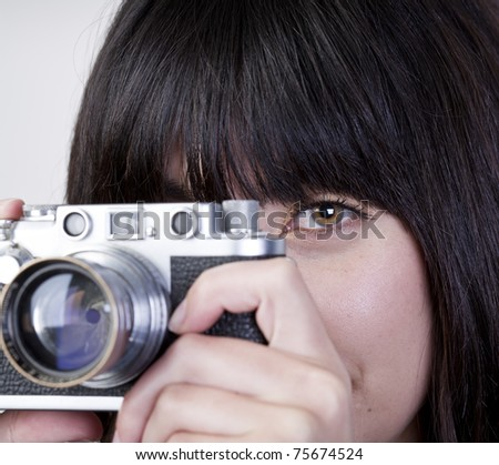 Close up of young girl with vintage camera