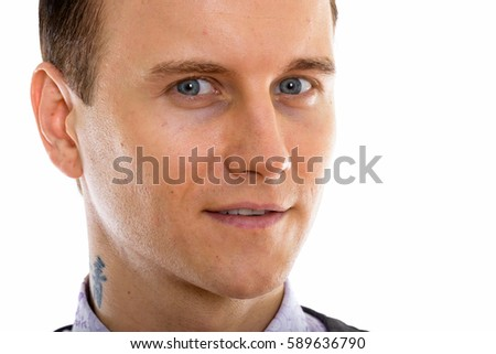 Close up of young happy businessman smiling