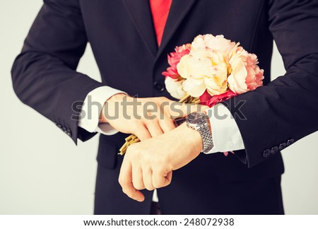 close up of young man giving bouquet of flowers - stock photo