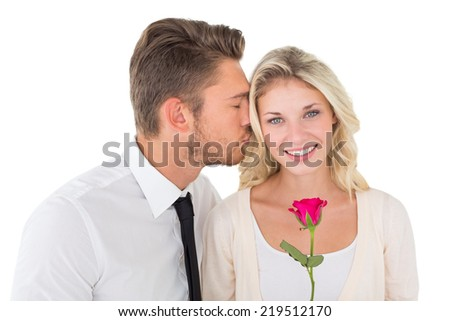 Close up of young man kissing happy woman over white background - stock photo
