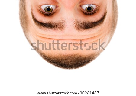Close-up of Young man looking down - stock photo