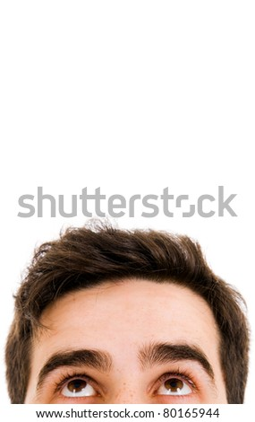 Close-up of young man looking up against white background - stock photo