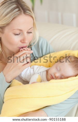 Close up of young mother enjoys being with her baby