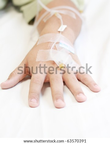 Close up of young patient hand recovering in hospital - stock photo