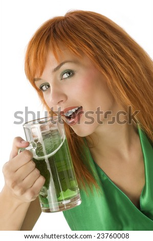 close up of young pretty woman with a glass of green beer