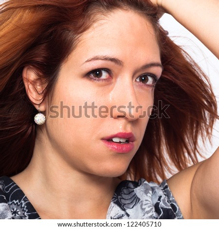 Close up of young sad woman crying. - stock photo