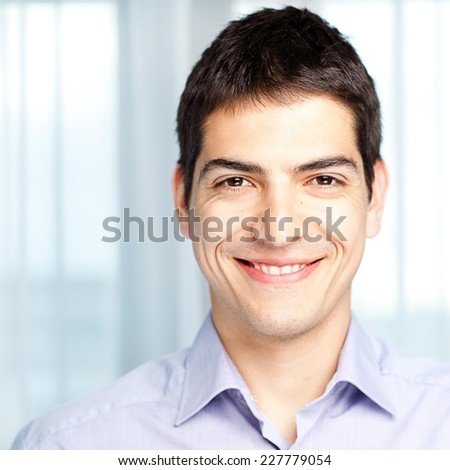 Close up of young smiling man.