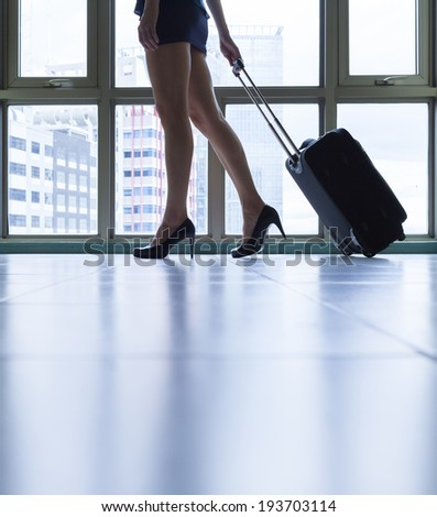 Close up of young woman arriving in a new city. Travel concept. - stock photo