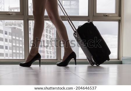 Close up of young woman arriving in a new city. Travel. Moving concept.